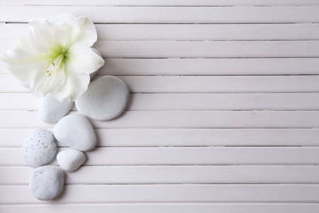 settings: Spa stones on wooden table