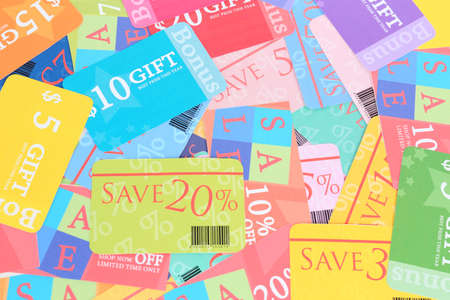Set of cut coupons for shopping to save money photo