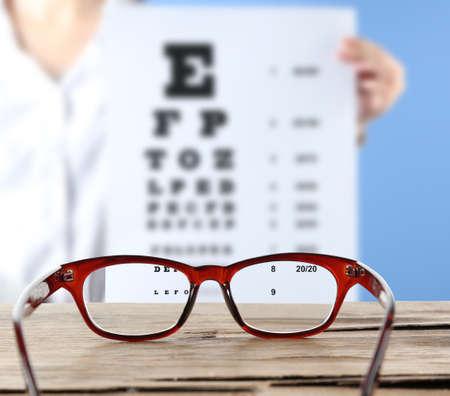 corrective: Eye glasses on wooden table