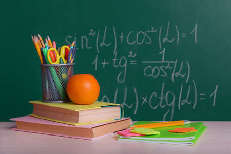 School supplies on table on board  photo