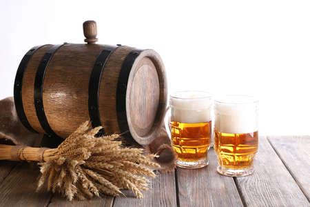 unbottled: Beer barrel with beer glasses on table on white background