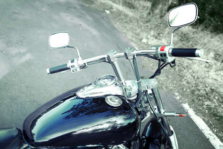 Motorcycle detail with gasoline tank and speedometer photo