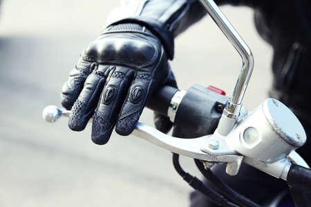 Hand rider on handlebars, close-up Standard-Bild