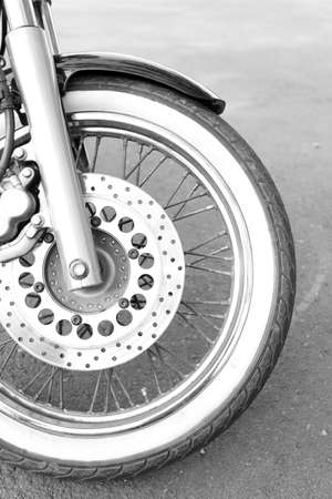Motorcycle forks and tire, close-up photo