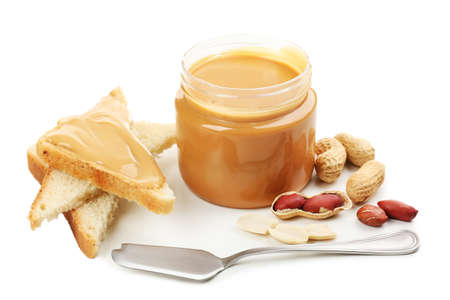 Creamy peanut butter, isolated on white photo