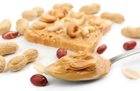 Creamy peanut butter in spoon, close-up photo
