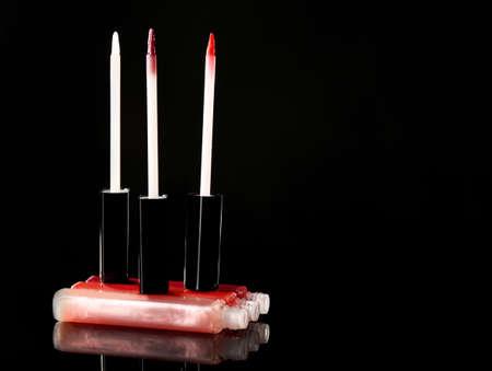beautify: Beautiful lip glosses on dark background Stock Photo