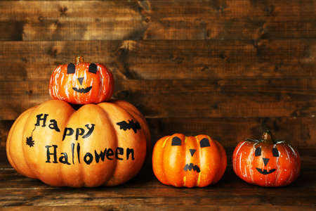 Halloween pumpkins on wooden table background