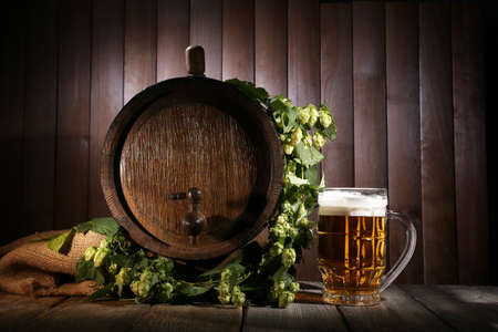 beer barrel: Beer barrel with beer glass on table on wooden background