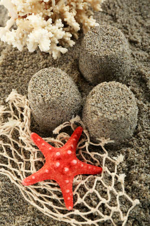 sandcastles: Sandcastles with starfish on sandy beach background Stock Photo