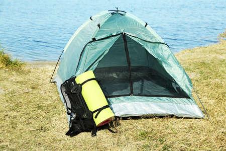 touristic: Touristic tent on dried grass near the sea