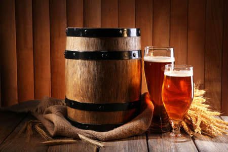beer barrel: Beer barrel with beer glasses on table on wooden background