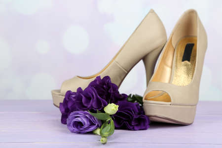 purple shoes: Beautiful woman shoes with flowers on bright background