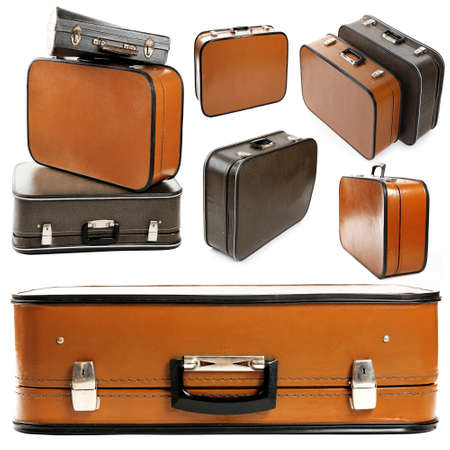 Collage of retro travel suitcases isolated on white photo