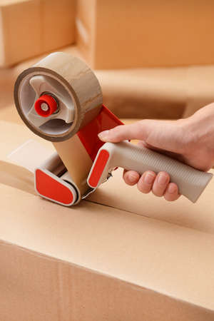 packing: Packaging parcels with dispenser close-up