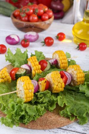 picks: Sliced vegetables on picks on board on table close-up Stock Photo