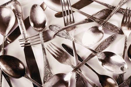 grunge flatware: Old disordered tableware closeup