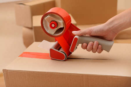 Packaging parcels with dispenser close-up photo