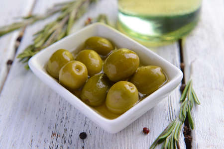 pitted: Marinated olives on table close-up