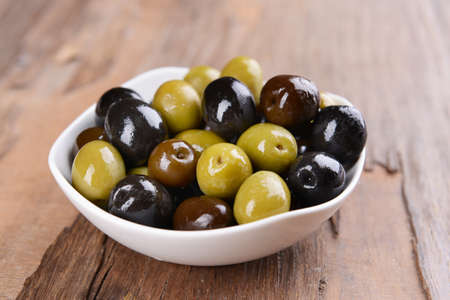 Different marinated olives on table close-up photo