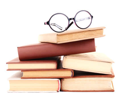 Books in a mess and glasses isolated on white photo