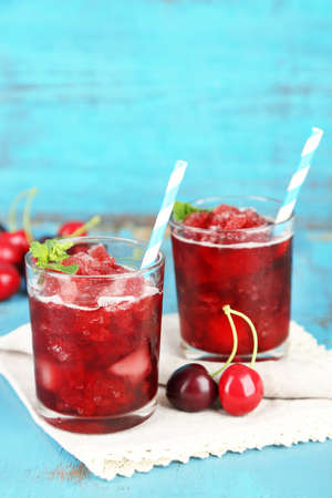 favored: Closeup of cherry granita in glasses, on color wooden
