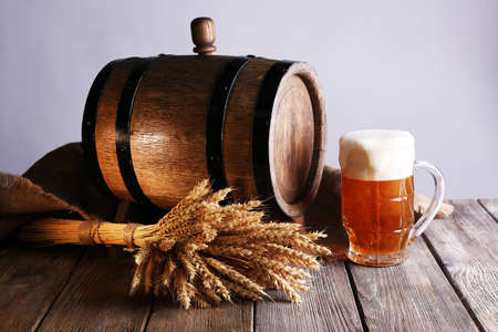 beer barrel: Beer barrel with beer glass on table on grey background