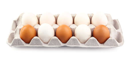 Different eggs in carton pack isolated on white photo