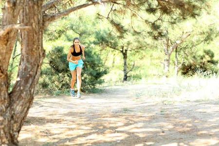 Young woman jogging at park photo
