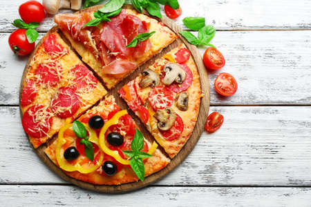 food plate: Delicious pizza served on wooden table Stock Photo