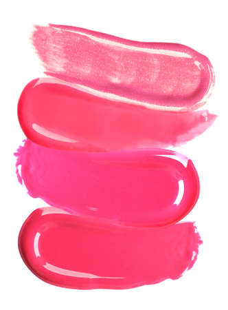 gloss: Different lip glosses isolated on white