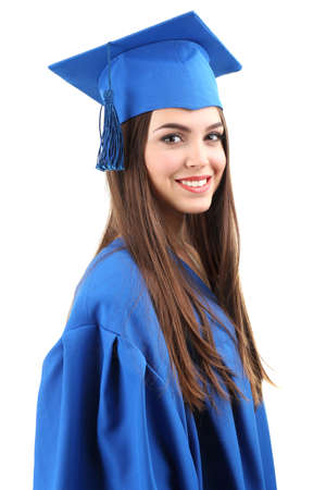 Woman graduate student wearing graduation hat and gown, isolated on white Stock Photo