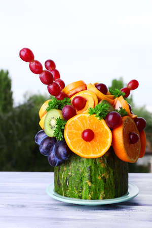 Table decoration made of fruits on table on natural background photo