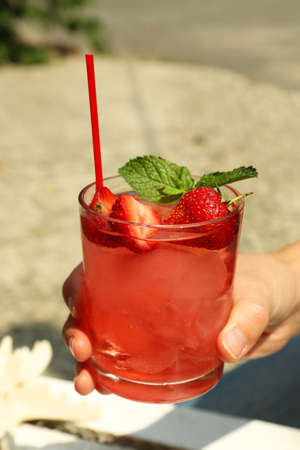 refreshing: Refreshing cocktail in hand