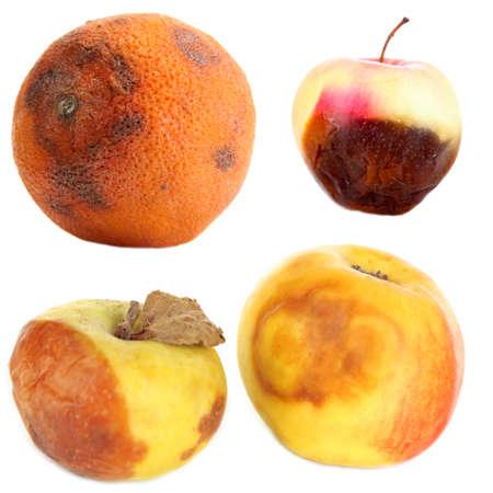 Rotten fruits isolated on white photo
