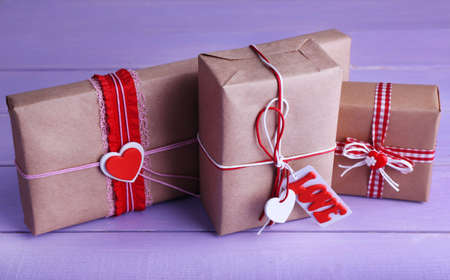 Three gift boxes on wooden background photo