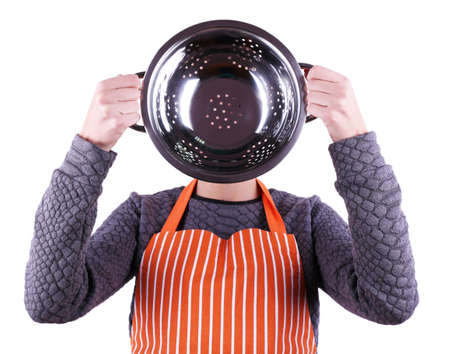 Cooker holding metal colander on light background photo