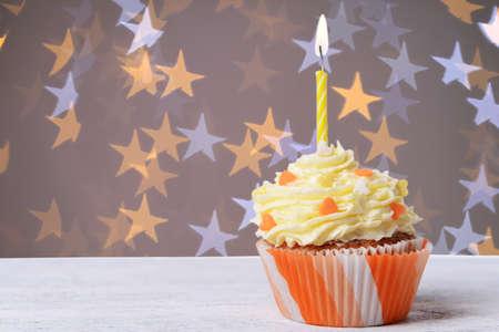 birthday cupcake: Delicious birthday cupcake on wooden table Stock Photo