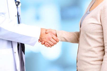 医師と患者、病院の背景 写真素材