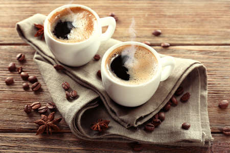 Two cups of coffee on wooden table photo