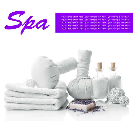 Spa setting on table isolated on white photo