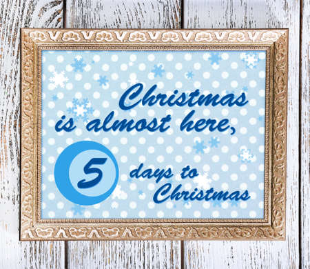 Christmas greeting card with frame on wooden background photo