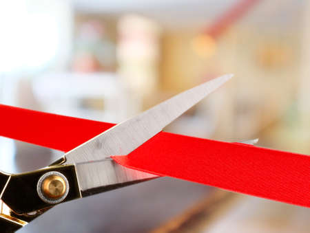 Grand opening, cutting red ribbon