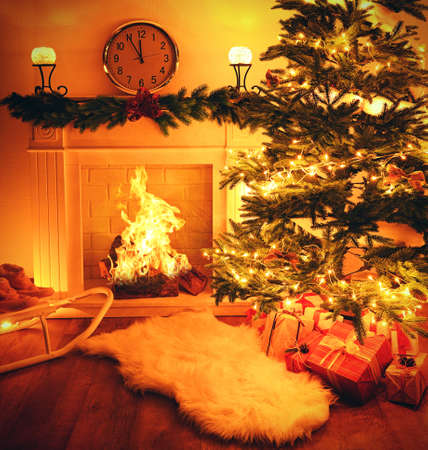 Christmas Tree Near Fireplace In Room Stock Photo, Picture And ...
