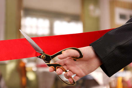 clippers: Grand opening, hand cutting red ribbon