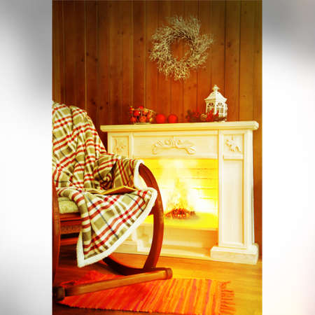 rocking: Rocking chair with plaid near fireplace Stock Photo