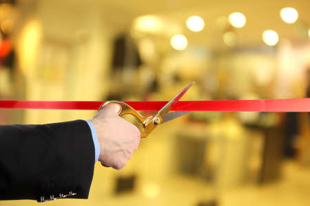 Grand opening, cutting red ribbon photo