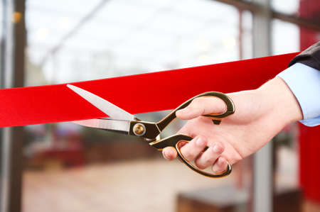 ribbon cutting: Grand opening, cutting red ribbon