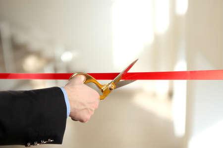 inauguracion: Gran apertura, cortando la cinta roja Foto de archivo