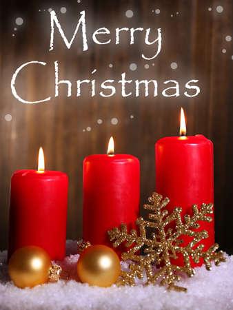 Burning candles on wooden background photo